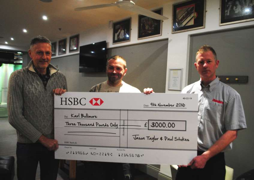 Paul Stokes, centre, and Jason Taylor present Karl Bullimore with a cheque for �3,000.