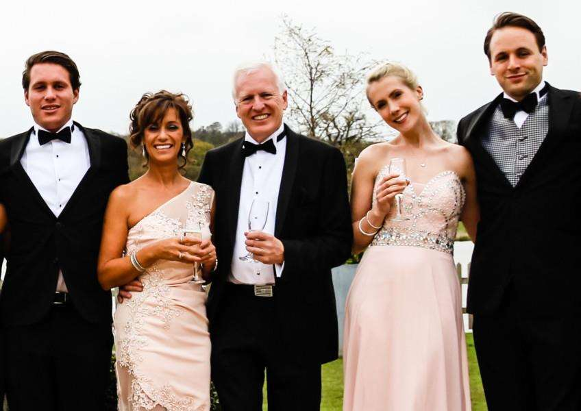 From left at the ball are Rosie May's brother Laurence Storrie, Rosie May's mum Mary, dad, Graham, Charlotte Storrie and Rosie May's brother Luke Storrie PHOTO: Fallen Oak Creative