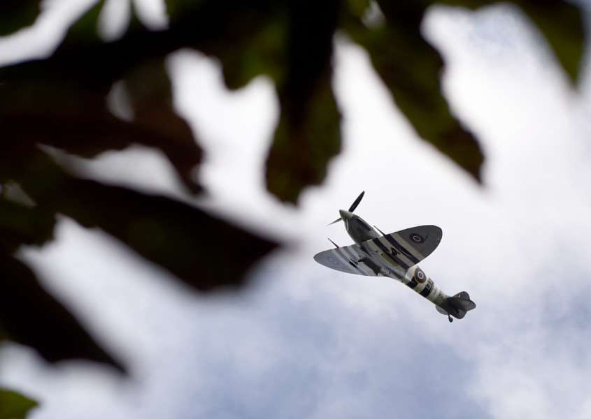 A Spitfire flies over Grantham Cemetery in tribute to Flying Office Robin Jaques, who was killed in an air crash near Old Somerby in 1923'TRP-13-8-2016-941A (13) EMN-160816-142705001