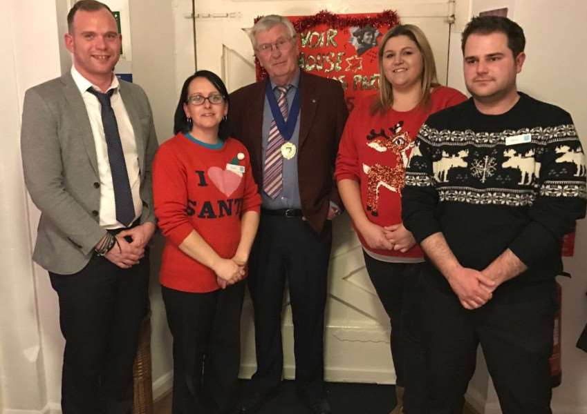 Pictured are Thomas Lovell (home manager), Tracey Wiles (Co-Op manager), Michael Cook (deputy mayor) and staff from Co-Op.