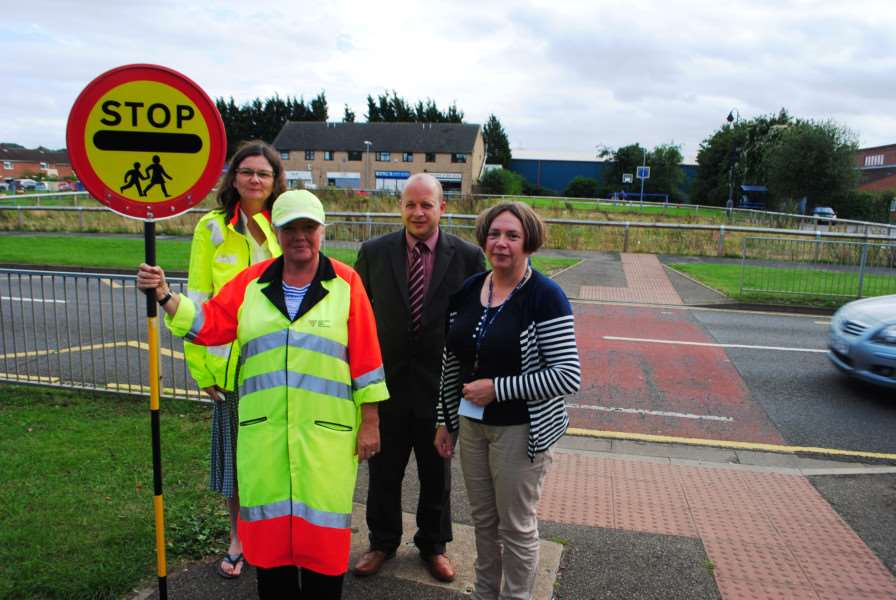 Lollipop lady Amanda Parke with, from left, road safety advisor Sara Bartlett, St John's acting headteacher Ian Woolerton and acting deputy headteacher Janet Thacker.