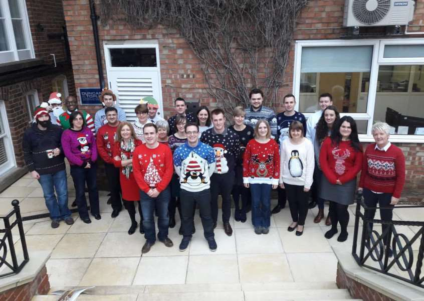 Duncan & Toplis support Save the Children by wearing their Christmas jumpers.