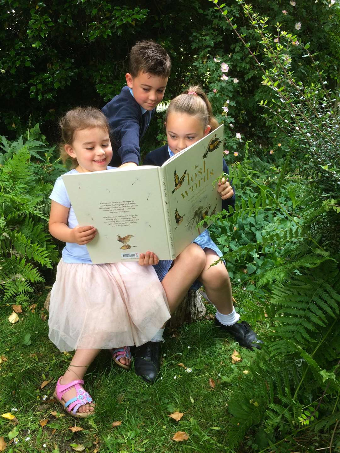 Ebony, Lochlan & Nylah Docherty, pupils at Ropsley Primary School, Lincolnshire read The Lost Words by Robert Macfarlane and Jackie Morris. (2607641)