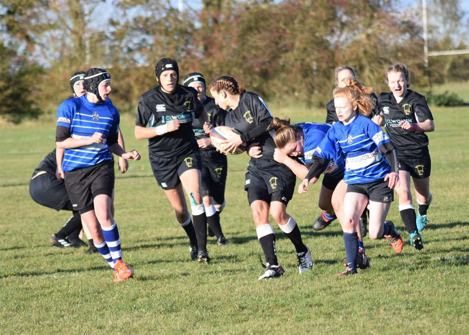 Kesteven's Hannah Dolby takes a tackle, supported by Sarah Jane Goss and Kerri Arlando.(5089456)