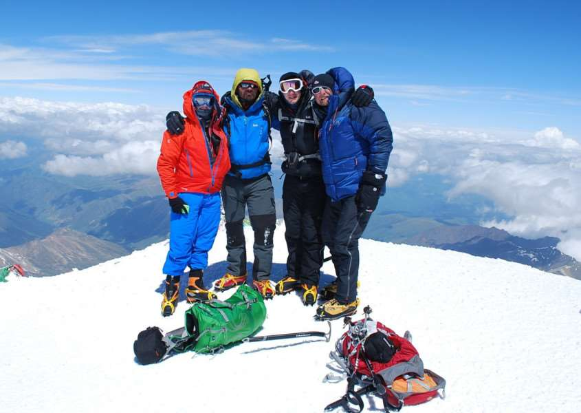 Chris Foster (right), of Long Clawson, with three team members at the summit of Mount Elbrus in Russia, Europe's tallest peak.'Photo supplied EMN-161228-131410001
