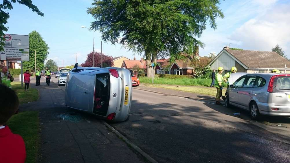 Crash on Dysart Road which left a vehicle on its side. Photo supplied.