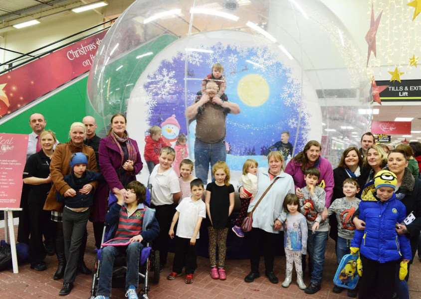 Grantham Disabled Children's Society families enjoy the indoor snowglobe at Downtown.