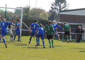 Number 17 Kieran Helmsdown heads home Sleaford's decisive second goal.