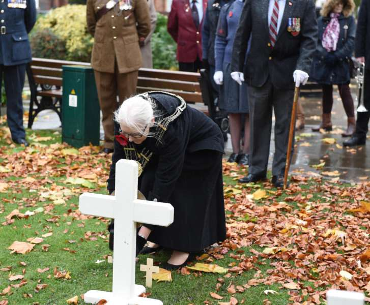 Mayor of Grantham Coun Linda Wootten plants a cross at the opening of the Garden of Remembrance in St Peter's Hill, Grantham, on Sunday.