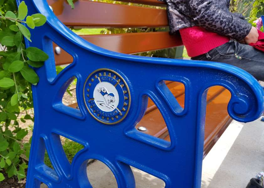 Surrounding the paddling pool in Wyndham Park, Grantham, are seats installed by the Rotary Club of Grantham, which feature the Swimarathon logo.