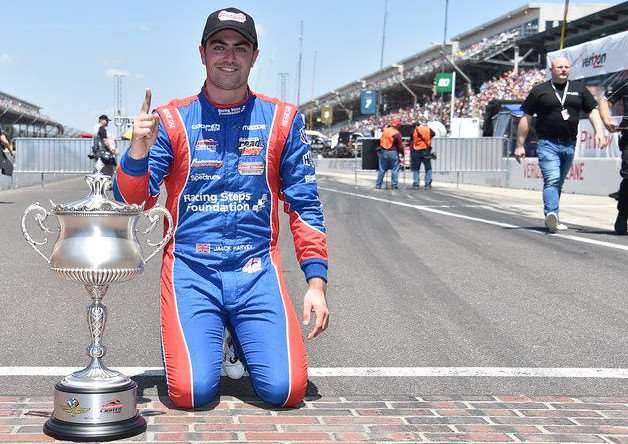 Indy Lights 100 race winner Jack Harvey shows off his latest silverware.