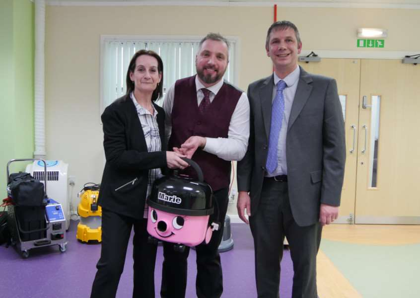 Pink Goddess founder Marie Tow with Domestic Cleaning Alliance director Stephen Munton and Paul Knight of vacuum cleaner manufacturer Numatic