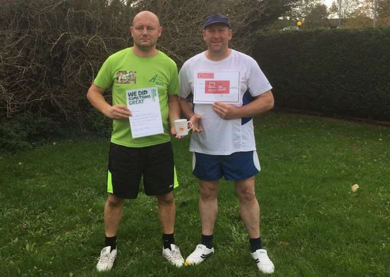 Mark Ward (left) and Des Adams raised over �1,000 for charity.