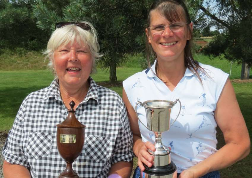 Pictured, from left, are Leglines Trophy winner Chris Thompson and ladies' club champion Amanda Roberts.