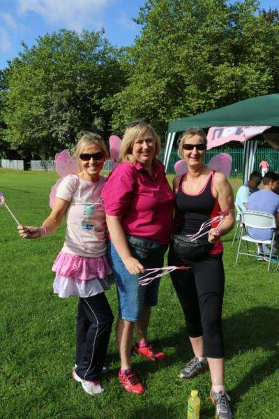 Rachel, Caroline and Louise with their magic wings at the Amazing Pink Ribbon Race in Wyndham Park, Grantham. EMN-160720-155218001