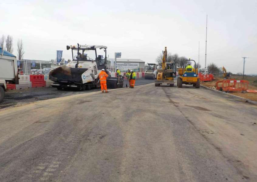 Tarmac being laid on the nothern access lane for the B1174 roundabout. Photo courtesy of Lincolnshire County Council.