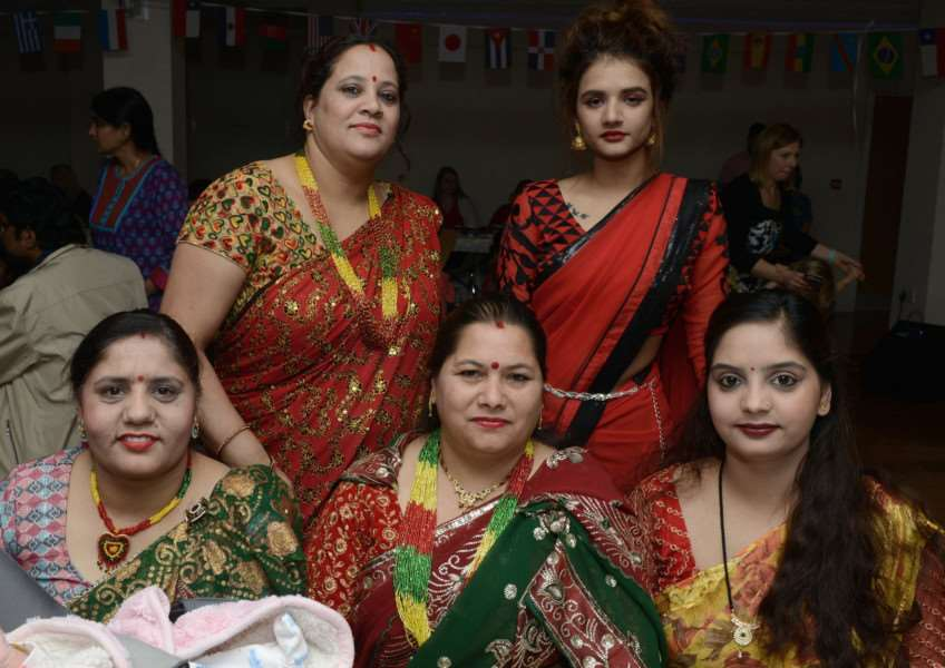 Debbie Gaire, Pooja Sharma, Indira Kandel Sharma, Kamala Sharma and Bishnu Gaire don their national dress to the party.