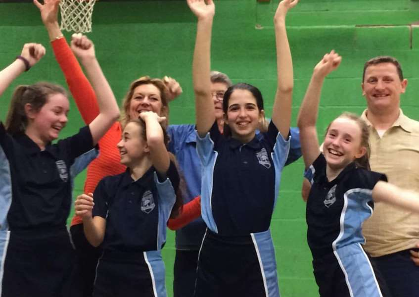 Priory Ruskin Academy under-13 girls celebrate victory.