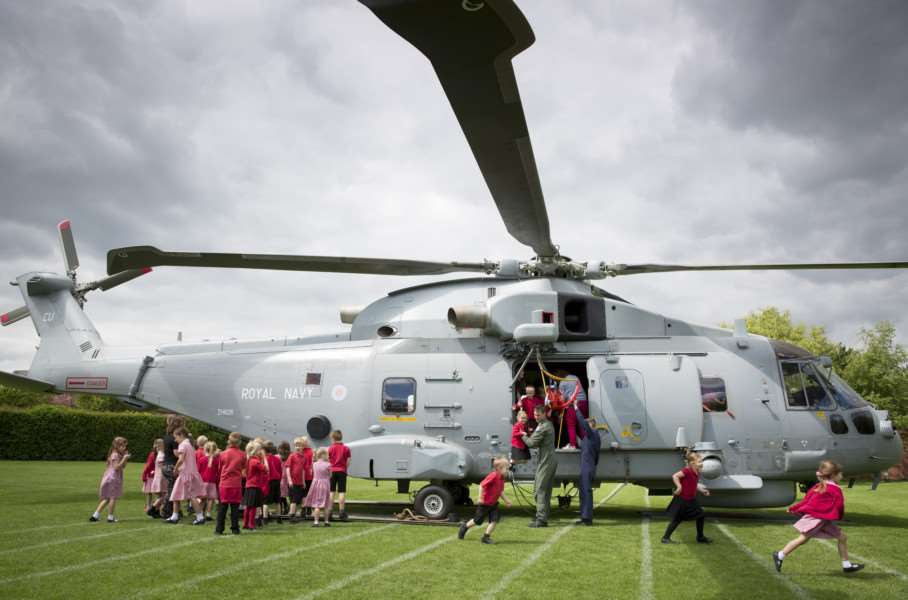 Pupils look around the Royal Navy Merlin at Long Bennington School.