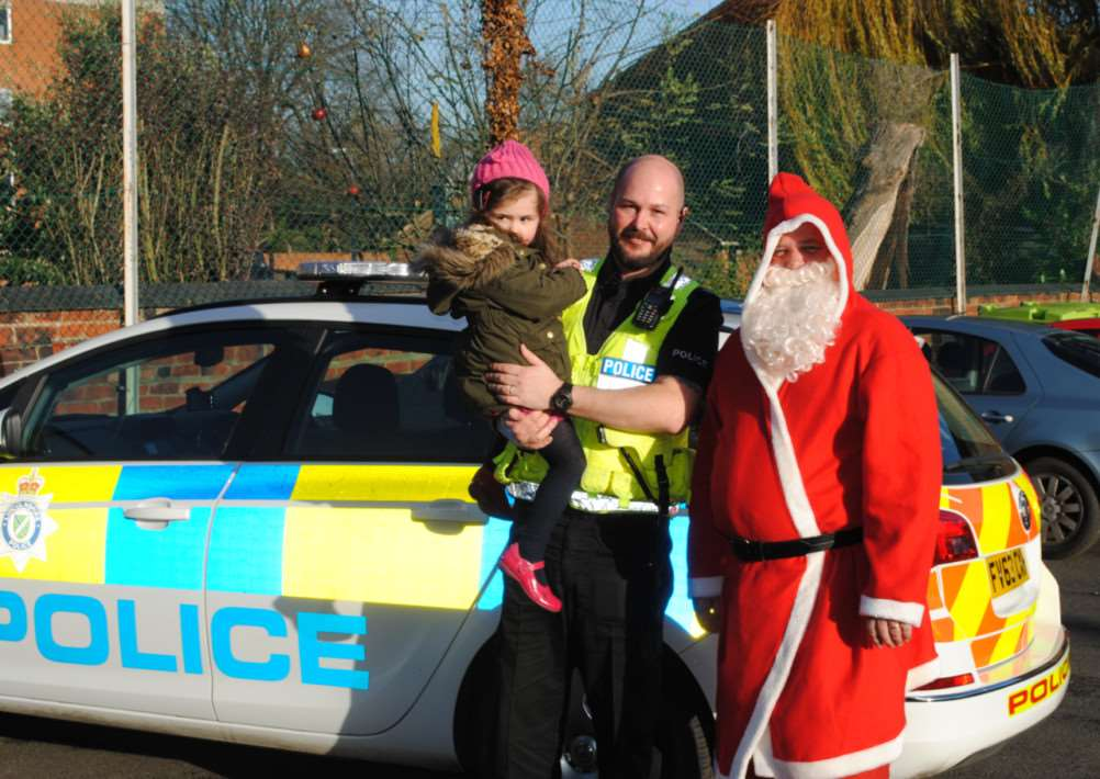 PC Bown, daughter Piper Bown and Santa with his new mode of transportation.