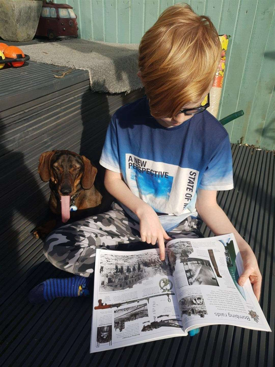 Seth reads out loud to his pet pooch Moose. (7609894)