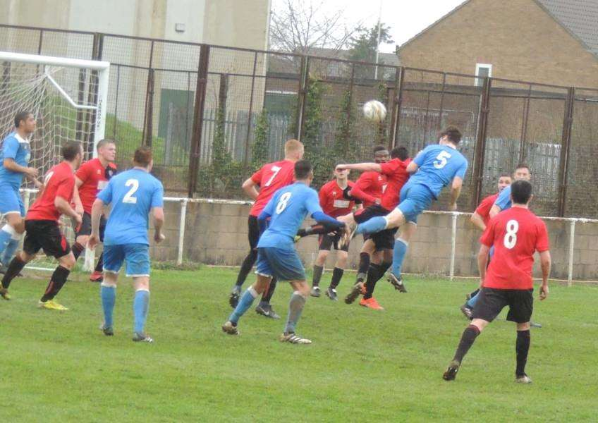 Leo Adams heads over as Harrowby defend a corner.