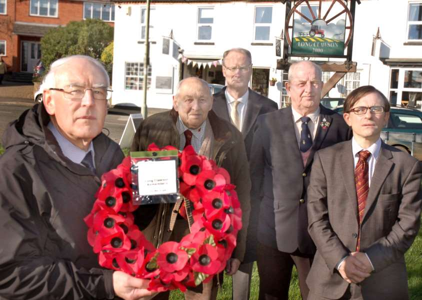 Holding the poppy wreath at the site where the memorial will go, on the village green at The Sands, is group leader pastor Eric Moxham with representatives from the three churches and the Royal British Legion. Pictured at the back, from left, are John Doubleday, Glen Arnold, Peter Hackett and Peter Sutton. EMN-161208-145749001