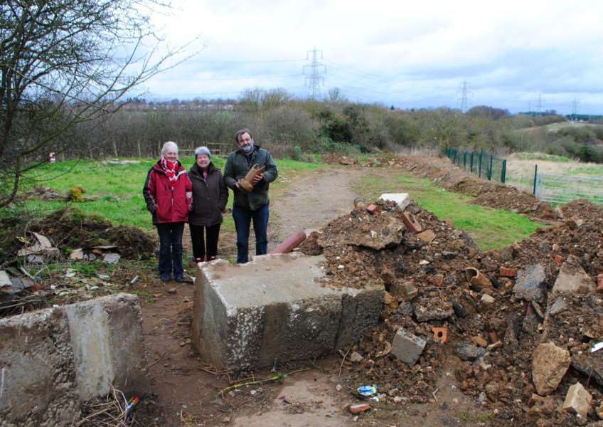 The entrance to Sheepwash Lane off Dysart Road has largely been blocked with concrete and earth. From left are Eve Abraham, Janet Elkington and Coun Mark Whittington.