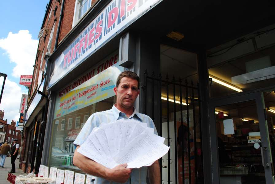 David Eggleston, of Tuffies discount store, with the petition he set up calling for an end to unfair parking restrictions on Westgate in Grantham.