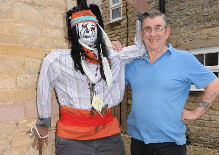 Scarecrow competition and Oasby and Aisby. Alan Moore of Oasby with his Tonto scarecrow. EMN-150107-175000001