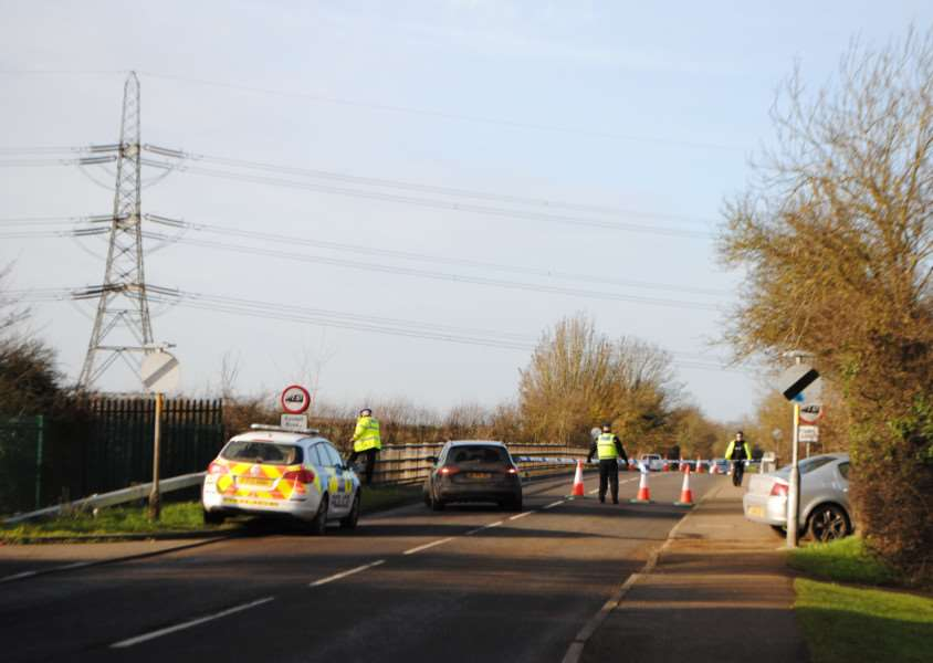 The bridge over the A1 at Dysart Road is cordoned off by police.