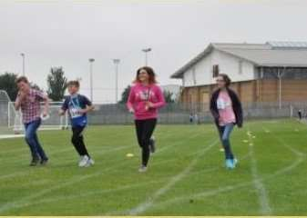 Group effort: Students from both West Grantham Academys took part in the Race for Life event last Friday.