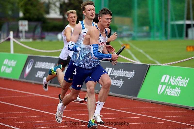 Lewis Dave takes the baton in the 4x400m relay on Sunday. Photo: Twitter - @tomsmeethphoto Instagram - @tsmeethphoto Facebook - Tom Smeeth (10881191)