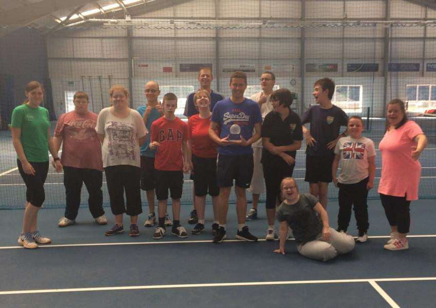 Grantham Tennis Club's learning disability class with Feeling Good's lead coach James Prior and the award.