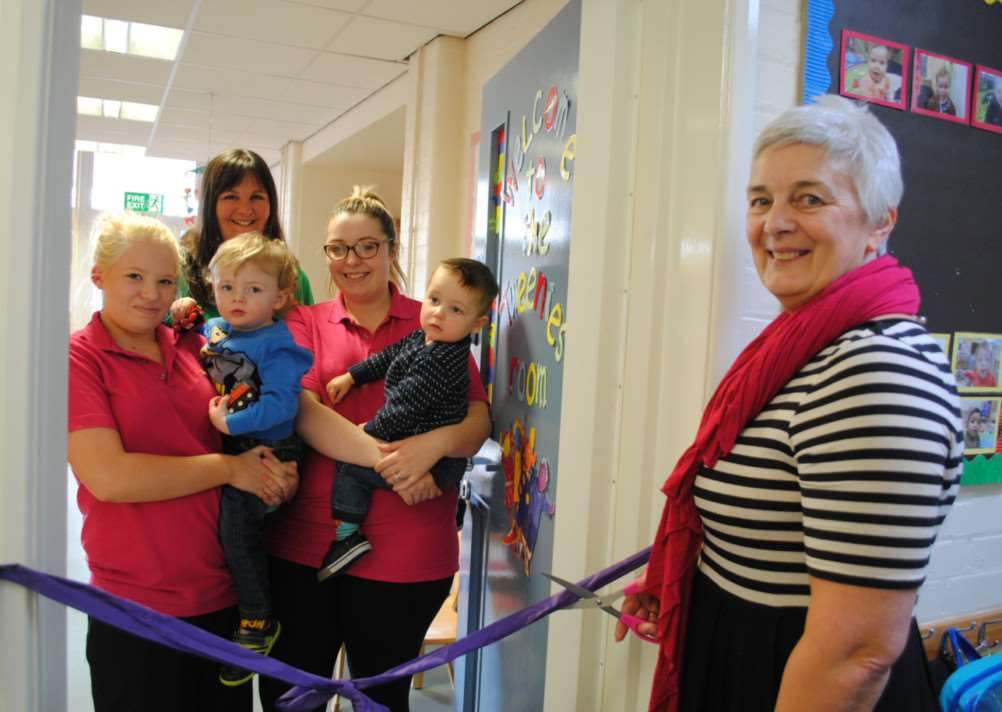 Mary Barlow cuts the ribbon to open the new baby room at Little Explorers Nursery in Grantham. Photo: 0306A