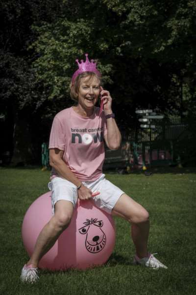 The Amazing Pink Ribbon Race organiser Sue Stannard takes a call during the spacehopper race. EMN-160720-155100001
