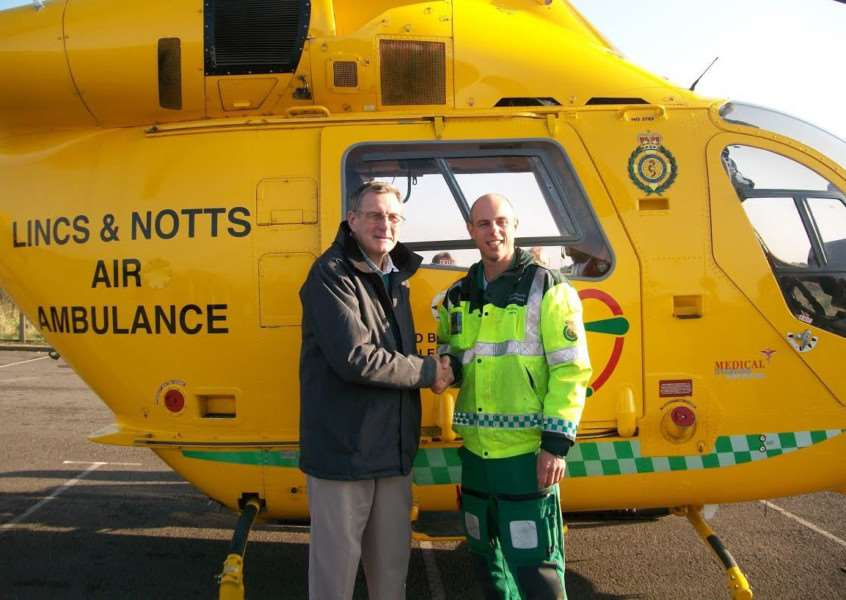 Belton Woods Seniors golf captain Ray Woodcock with paramedic Rich Irwin of the Lincs and Notts Air Ambulance.