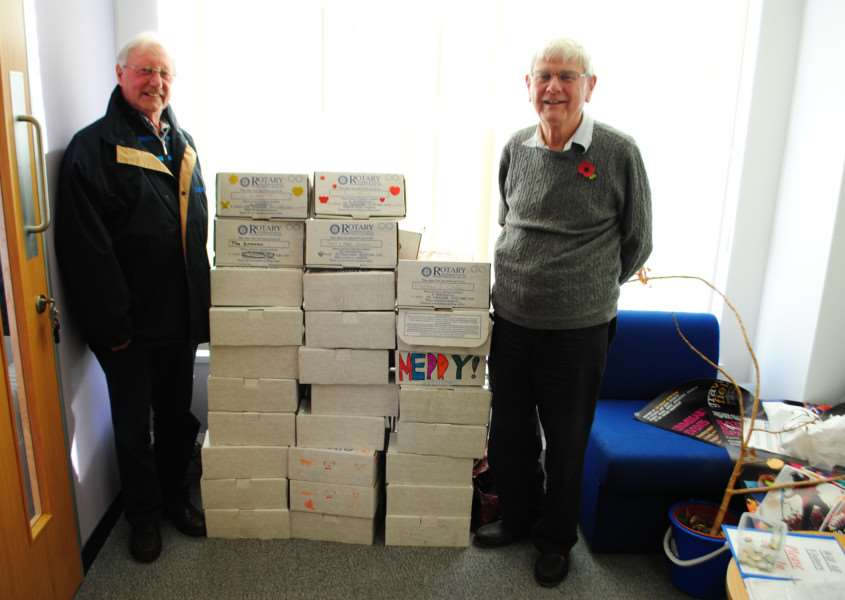 Mike Charity and Tony Griffin, of the Rotary Club of Grantham Kesteven with Rotary Boxes collected at the Grantham Journal.