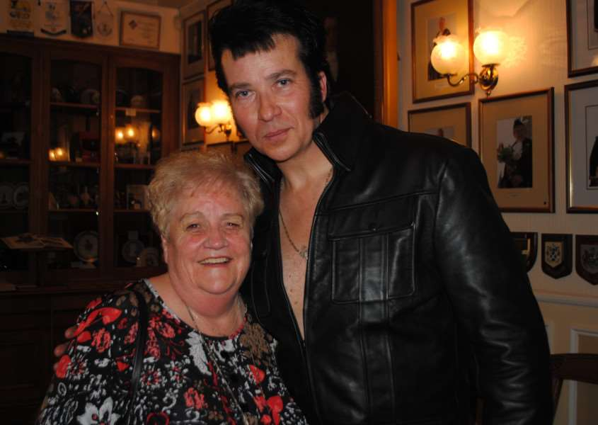 Elvis tribute singer Mike Shelby with audience member Mary Smith.