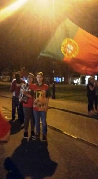 Waving the Portuguese flag in Grantham town centre after their country's victory in the European Championships.