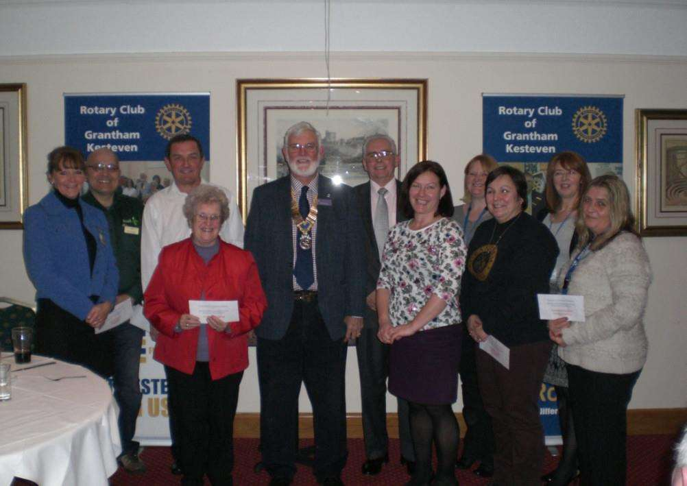 President of Rotary Club Grantham Kesteven Bob MacKinlay with representatives of local charities.