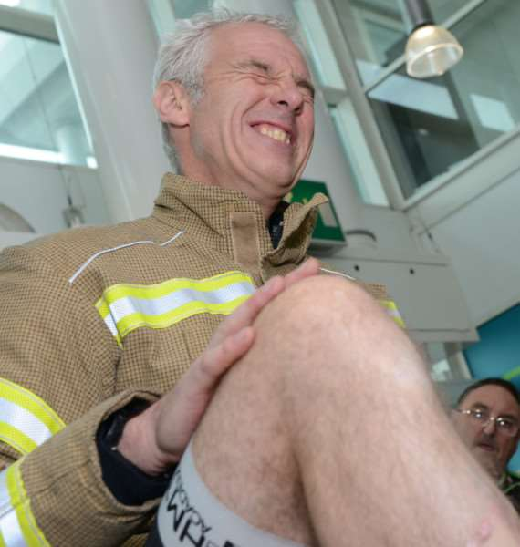 Firefighter Clive Baillie feels the pain as he has his legs waxed for charity at Asda.