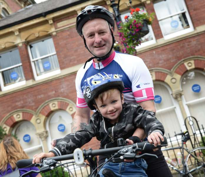 Dean Fardell and young cyclist after the Naomi Fund Bike Challenge.