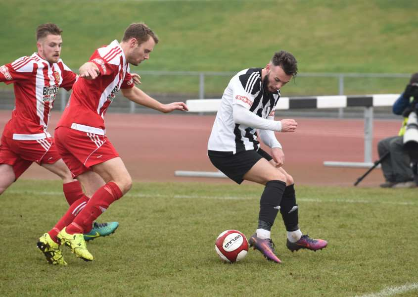 Curtis Currows (right) set up Harry Clifton up for Grantham Town's second goal. Photo: Toby Roberts