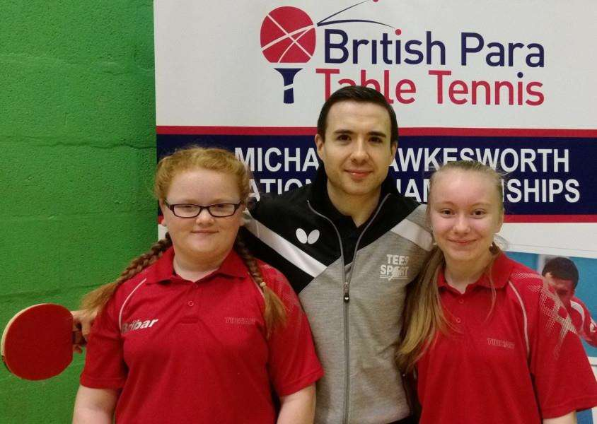 Walton Girls pupils Emily Winfield and Abigail Robinson with 2016 Para Olympic champion Will Bayley MBE.