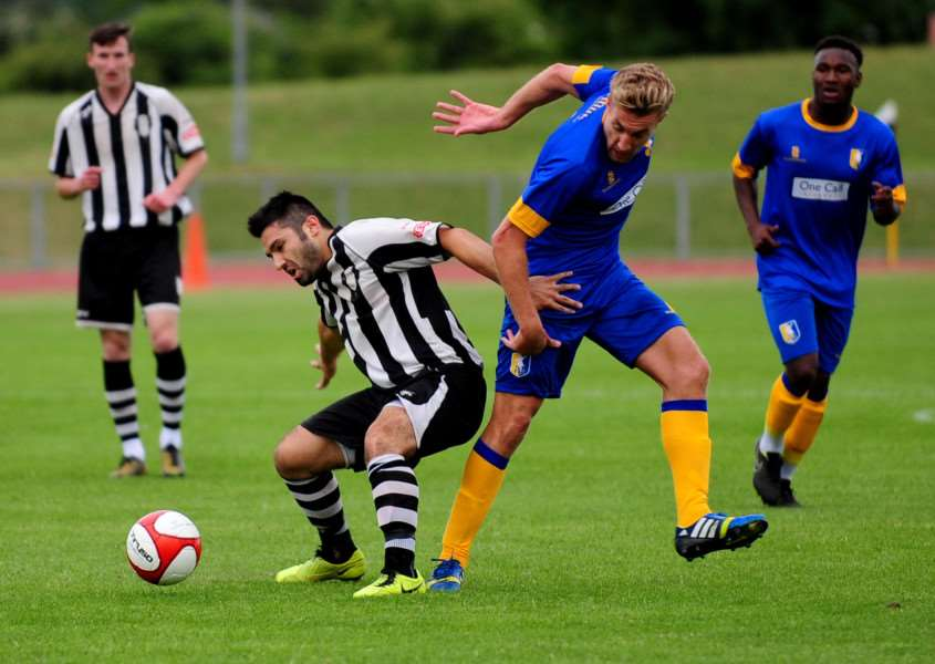 Gio Carchedi (left) scored Grantham Town's opener against Mansfield. Photo: Toby Roberts