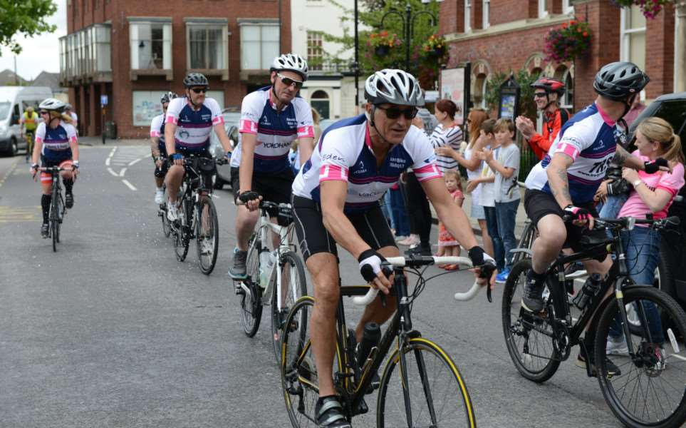 Coming home. Riders in the Naomi Find Bike Challenge reach the finish outside the Guildhall in Grantham.