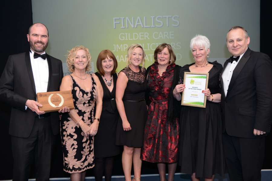 JMP Solicitors, including MD Ian Howard, left, collect their award from June Parker, second left, of sponsors Downtown.