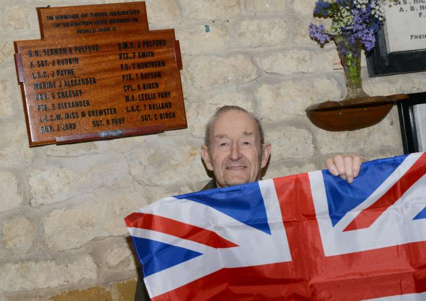 Stanley Birch unveils the plaque dedicated to the survivors of World War Two in Sproxton.