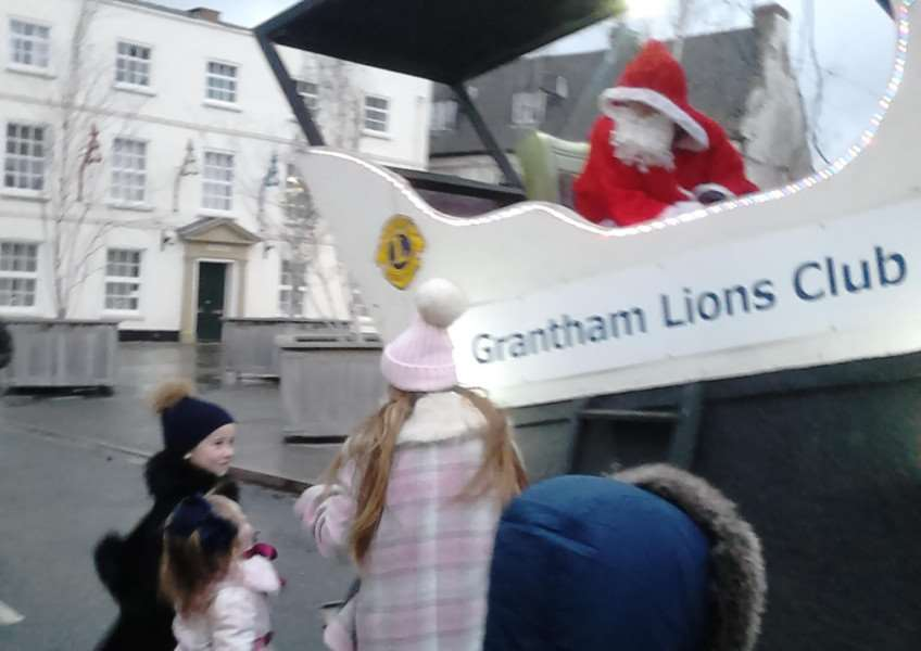 Santa on his Grantham Lions Club sleigh meets youngsters on his tour of the town.